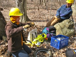 Trail builder and educator Ama Koenigshof, left, demonstrates trail rigging to volunteer trail crew members. The advanced workshop was given April 7 at Harriman State Park.