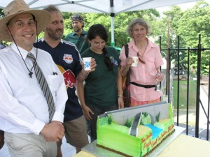 (l to r) Gary Ricci, Manager of Old Croton Aqueduct (OCA) State Historic Park; Bob Kornfeld, Vice President, Friends of OCA; Megan Sylvestri, OCA;  and Mavis Cain, President of Friends of OCA with commemorative cake  contributed by Del Sol Sweet Pastry in Ossining. Photo credit: Andrea Minoff