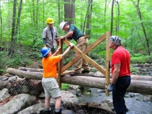 Volunteers working on the construction of the bridge
