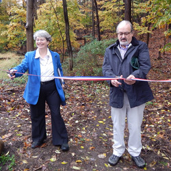 OPRHP Assistant Commissioner Carol and Winter Hill's Chris Buck cut the ribbon to open the new trail extension on new park land.