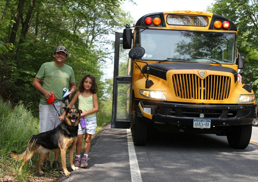 Shuttle bus riders with dog