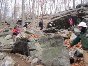 The crew and friends hike the new trail. (Photo credit: Marty Costello)