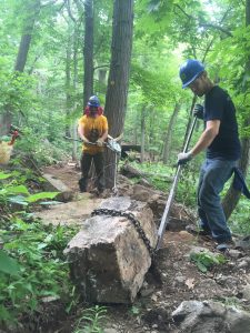 Taconic Crew members Jake and Chris using the grip hoist to move a stair into place.