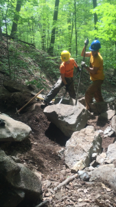Crew Members Ross and Chris removed several rocks from the planned route to clear a path to install stepping stones.